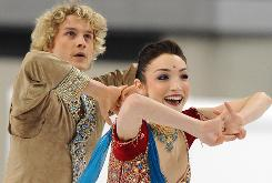 Charlie White and Meryl Davis perform their original dance at the World Figure Skating Championships on Thursday at the Palavela in Turin.