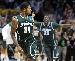 Michigan State's Korie Lucious (34) reacts after hitting the game-winning three-pointer in the Spartans' victory over Maryland in the second round on Sunday. Lucious is now thrust into the starting lineup after starting point guard Kalin Lucas went down with a torn Achilles' tendon.