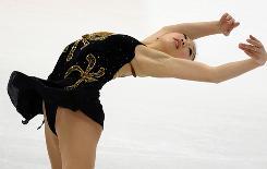 Mirai Nagasu performs Friday at the World Figure Skating Championships in Turin, Italy.