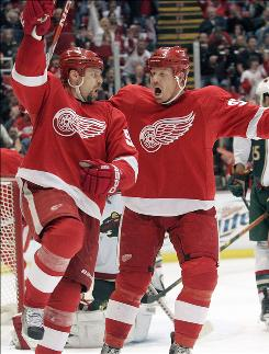 Johan Franzen, right, celebrating with Red Wings teammate Tomas Holmstrom, notched his first career four-point night with two goals and two assists to help Detroit win its fourth straight game.