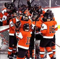 Rochester Institute of Technology's hockey team celebrates after defeating No. 2 overall seed and East Regional No. 1 seed Denver at the Times Union Center during the Tigers' first apperance in the NCAA Division I hockey tournament.