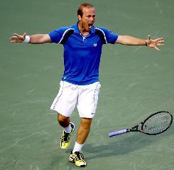 Olivier Rochus reacts after defeating Novak Djokovic, a former champion at Key Biscayne.