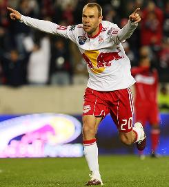 The Red Bulls' Joel Lindpere celebrates his game-winning goal in the 40th minute against the Chicago Fire that opened Red Bull Arena in style.