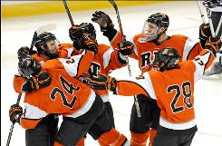 Rochester Institute of Technology players celebrate a first-period goal as the Tigers advanced to their first Frozen Four.