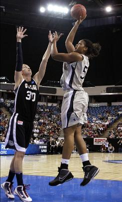Xavier's Ta'Shia Phillips shoots over Gonzaga's Heather Bowman during the first half of the Musketeers' win in Sacramento.
