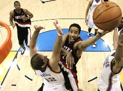 Portland Trail Blazers guard Andre Miller goest to the basket against Oklahoma City Thunder center Nenad Krstic in the first quarter. Miller finished the game with 26 points.