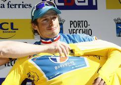 Pierrick Fredrigo gets the leader's yellow jersey after winning the Criterium International on Corsica.