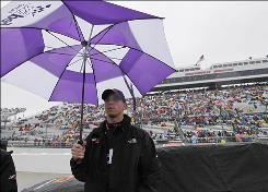 Denny Hamlin waits out a rain delay on the pit lane at Martinsville Speedway.