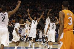 Michigan State players celebrate after the buzzer sounded on their 70-69 victory over Tennessee Midwest Regional final in St. Louis.