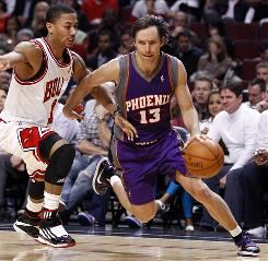 Steve Nash scored 22 points and dished out 10 assists to help the Suns beat Derrick Rose and the Bulls Tuesday night in Chicago 111-105. Rose had 23 points and 10 assists.