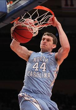 North Carolina's Tyler Zeller dunks the ball against Rhode Island at Madison Square Garden in New York. The Tar Heels will meet Dayton's Flyers in the NIT championship game.