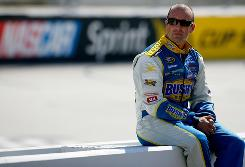 Marcos Ambrose sits on the pit wall in between practice sessions at Bristol Motor Speedway.