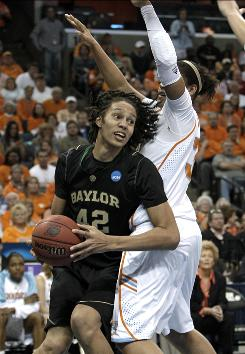 "Baylor's Brittney Griner drives past Tennessee forward Alyssia Brewer, right, during Baylor's upset win in the NCAA tournament. Griner, a 6-8 freshman, has a record-setting 35 blocks in the tournament. ""She's a once-in-a-lifetime player,"" Baylor coach Kim Mulkey says."