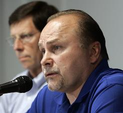Nashville Predators coach Barry Trotz, right, and general manager David Poile have been together since the franchise's opening day.