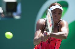 Venus Williams of the USA powers a backhand during her victory Thursday against Marion Bartoli of France in the semifinals of the Sony Ericsson Open at Key Biscayne, Fla. Williams has won 15 matches in a row.