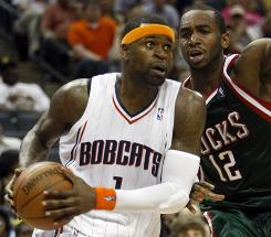 Bobcats guard Stephen Jackson drives to the basket past Bucks forward Luc Mbah a Moute during the second half. Jackson scored 32 points as Charlotte won in overtime to gain ground in the playoff race.