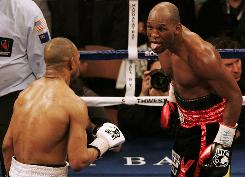 Bernard Hopkins sticks his tongue out at Roy Jones Jr. during the 10th round of their light heavyweight fight. Hopkins won the brutal fight in a unanimous decision to avenge a 1993 loss to Jones.