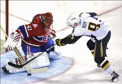 Montreal Canadiens goaltender Jaroslav Halak, making a save against the Buffalo Sabres' Derek Roy, recorded his second shutout in two nights and his fifth of the season.