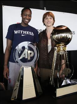 Connecticut center Tina Charles, left, and Nebraska head coach Connie Yori pose with their awards at the Final four festivities in San Antonio.