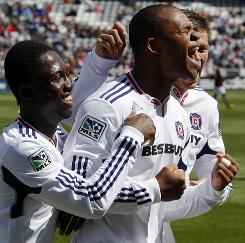 Chicago's Collins John, front right, celebrates his goal against Colorado with teammates Patrick Nyarko, left, and Krzysztof Krol during the first half.