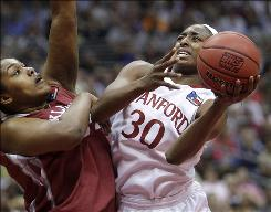 Stanford's Nnemkadi Ogwumike (30), taking a shot against Oklahoma's Abi Olajuwon, scored a career-high 38 points to propel the Cardinal into Tuesday's championship game.