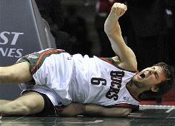 The Bucks lost center Andrew Bogut for the season Saturday when he broke his right hand and dislocated his right elbow.