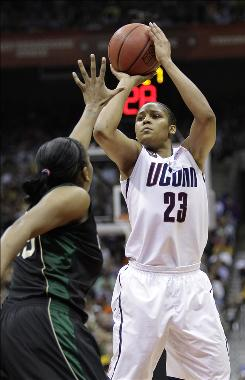 Connecticut forward Maya Moore shoots over Baylor forward Morghan Medlock, left, in the first half. Moore had 34 points and 12 rebounds as Connecticut advanced to the tournament championship game.