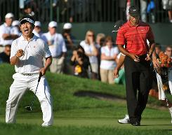 Y.E. Yang of South Korea celebrates in front of a dejected Tiger Woods after coming from behind on Sunday to beat Woods at the 2009 PGA Championship at Hazeltine National Golf Club in Chaska, Minn.