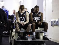 Butler's Gordon Hayward, left, and Shelvin Mack head to the locker room after losing to Duke.