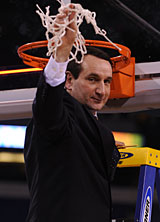 Duke coach Mike Krzyzewski cuts down the nets after winning his fourth national championship with the Blue Devils.
