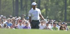Fans brandishing their cameras focus on Tiger Woods on Monday during his practice round for The Masters at Augusta National Golf Club.