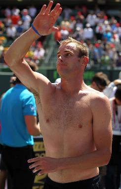 Andy Roddick of the USA celebrates his victory Sunday against Tomas Berdych of the Czech Republic in the final of the Sony Ericsson Open in Key Biscayne, Fla. Roddick claimed his second title in Key Biscayne and his 29th career title.