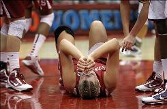 Stanford's Jayne Appel reinjured her right ankle and finished her final game as a Cardinal shooting 0 for 12 in the loss to Connecticut in the NCAA championship game.