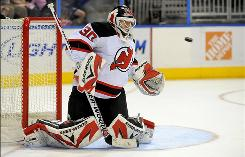 Devils goalie Martin Brodeur, stopping a Thrashers shot during the second period, earned his ninth shutout of the season and 110th of his career.