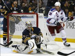 Sabres goalie Ryan Miller makes a save under pressure from the Rangers' Vinny Prospal during the second period Tuesday night in Buffalo. Miller made 30 saves in the Sabres' 5-2 win.