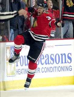 The Blackhawks' Kris Versteeg, celebrating after scoring a first-period goal, ended the game with four points, the first for a Chicago player since 2008.