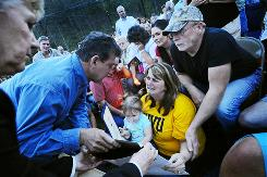 W.Va. Gov. Joe Manchin gives a state certificate to the family of deceased coal miner Josh Napper on Wednesday. Napper was among the 25 miners killed on Monday along at an explosion at Massey Energy's Upper Big Branch Coal Mine in Montcoal, W.Va.