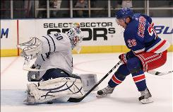 Despite getting stopped by Maple Leafs goalie Jonas Gustavsson during the second period, the Rangers' Erik Christensen scored twice to keep New York's playoff chances afloat.