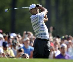 Tiger Woods cranks a tee shot on 12th hole during a practice round for the Masters at Augusta National in Georgia.
