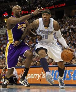 Denver's Carmelo Anthony drives to the basket past Los Angeles forward Lamar Odom.