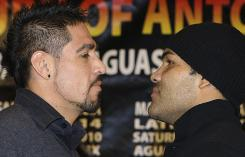 Antonio Margarito, left, of Mexico, and Roberto Garcia pose for their fight scheduled for May 8 in Aguascalientes, Mexico.