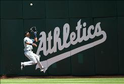 Mariners center fielder Franklin Gutierrez makes a running catch on a ball hit by Kevin Kouzmanoff during the Athletics' 6-2 win.