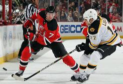 Devils defenseman Paul Martin, left, could make $5 million a year if he hits the free-agent market.