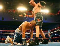 Kelly Pavlik knocks down Miguel Espino during their match in his hometown of Youngstown, Ohio, last December.