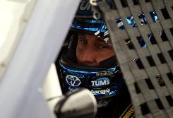 David Reutimann buckles in for practice earlier this season at Las Vegas Motor Speedway.