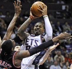 Nets rookie Terrence Williams shoots over the Bulls' Hakim Warrick during the first quarter. Williams became the first New Jersey rookie to register a triple double since 2001 as the Nets won to keep the Bulls tied with the Raptors for the final playoff spot in the East.