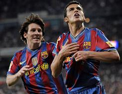 Barcelona's Pedro Rodriguez, right, and Lionel Messi both scored in Saturday's 2-0 victory over Real Madrid to take a three-point lead atop the Spanish league.