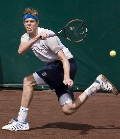 Sam Querrey raps a return during his semifinal victory Saturday against fellow American Wayne Odesnik at the U.S. Men's Clay Court Championships in Houston.
