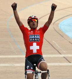 Switzerland's Fabian Cancellara reacts on his way to the finish line to win the 108th edition of the Paris-Roubaix classic race.
