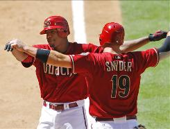 The Diamondbacks' Chris Snyder greets pitcher Edwin Jackson following Jackson's first career home run.